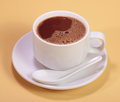 Hot chocolate drink a cup of on simple yellow background Stock Images