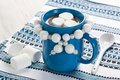 Hot chocolate with marshmallow in blue mug for winter drink Royalty Free Stock Image