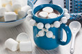 Hot chocolate with marshmallow in blue mug for winter drink Royalty Free Stock Photography