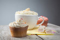 Hot chocolate with marshmallows, cream and cupcakes Stock Image