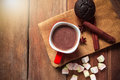 Hot chocolate with marshmallows on old wood background