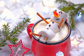 Hot chocolate with melted snowman red mug marshmallow Royalty Free Stock Photo