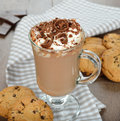 Hot chocolate with whipped cream on a brown background Royalty Free Stock Image