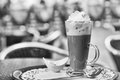 Hot chocolate with whipped cream on outdoors table shallow dof closeup image Stock Images