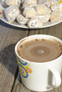Hot chocolate in white mug with crescent rolls stuffed with waln Royalty Free Stock Photo