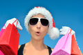 Hot christmas shopping attractive woman with santa hat holding bags Royalty Free Stock Photos