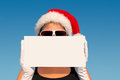 Hot christmas vacation attractive woman with santa hat on Stock Images