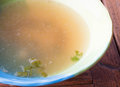Hot clear soup boiled from pork in ceramic bowl Royalty Free Stock Photo