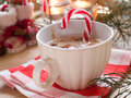 Hot cocoa drink with candy stick selective focus Stock Photography