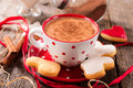 Hot cocoa drink and milk with heart shape cookies selective focus on the cup Royalty Free Stock Photo