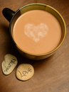 Hot cocoa with heart chocolate in center of mug Royalty Free Stock Image