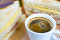 Hot coffee with big sandwiches for breakfast. Royalty Free Stock Photo