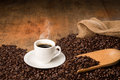 Hot coffee cup on a bed of coffee beans Royalty Free Stock Photo