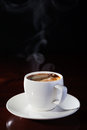 Hot coffee cup of fragrant on a wooden table Royalty Free Stock Photography