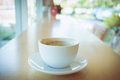 Hot of coffee drink on wooden table bar Royalty Free Stock Photo