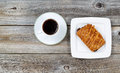 Hot coffee and freshly baked croissant top view of fresh chocolate filled on vintage wood Stock Photos