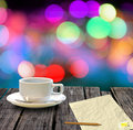 Hot coffee and letter paper on table with bokeh Stock Image