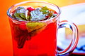 Hot cranberry tea with mint Stock Photo