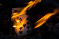 Hot cribbage hand bursting into flame Royalty Free Stock Photography