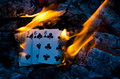 Hot cribbage hand bursting into flame Royalty Free Stock Image