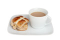 Hot cross bun and tea Stock Photos