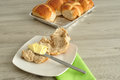 Hot cross buns, butter, knife and green napkin Royalty Free Stock Photo