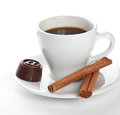 Hot cup of coffee with cinnamon sticks Royalty Free Stock Image