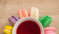 Hot cup of red tea  colored cakes Royalty Free Stock Photo