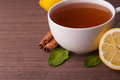 Hot cup of tea and fresh lemons Royalty Free Stock Photos