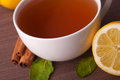 Hot cup of tea and fresh lemons Royalty Free Stock Photo