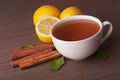 Hot cup of tea and fresh lemons with mint Stock Image