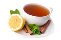 Hot cup of tea and fresh lemons on white Royalty Free Stock Image