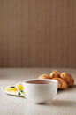 Hot cup of tea with lemon and croissants Stock Images