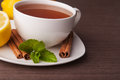Hot cup of tea and mint with lemon Stock Photos