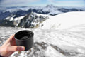 Hot cup of tea on mountain top in winter hand holding a Royalty Free Stock Photography