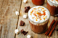 Hot dark chocolate with whipped cream cinnamon and salted caram caramel the toning selective focus Royalty Free Stock Photography