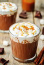 Hot dark chocolate with whipped cream cinnamon and salted caram caramel the toning selective focus Stock Image