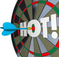 Hot dart popular great performance dartboard a hits the center of a bulls eye with the word to illustrate a job or perfomance and Stock Photography