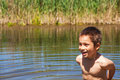 Hot day bathing in river happy boy a summer Stock Images