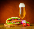 Hot Dog Sandwich with Glass of Cold Beer Royalty Free Stock Photo