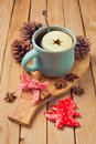 Hot drink with apple and spices for Christmas celebration Royalty Free Stock Photo