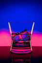 Hot drink shots in bar on color abstract background Royalty Free Stock Photo