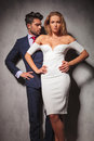Hot elegant fashion couple standing with hands on hips Royalty Free Stock Photo