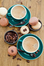 Hot espresso and french macaroons Royalty Free Stock Image