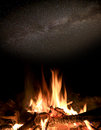 Hot fire under night sky scene with camn stars in Stock Image
