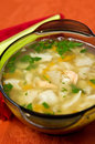 Hot fish soup delicious dish of served in glass bowl Stock Image