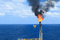 Hot flare boom and fire on offshore production platform Royalty Free Stock Photo