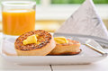 Hot fresh crumpets with butter melting on top Royalty Free Stock Photo
