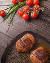 Hot fresh steaks on pan Royalty Free Stock Photo