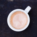 Hot frothy cup of cappuccino or cafe au lait Royalty Free Stock Photo